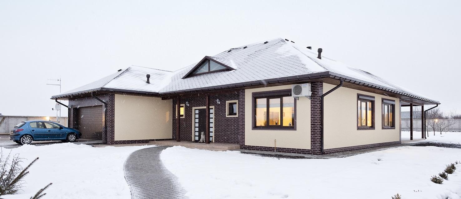 Каркасный дом зимой